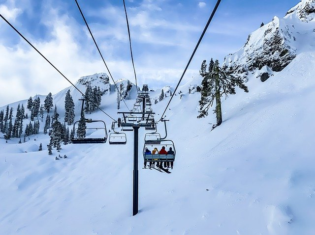 a ski lift in snowy conditions
