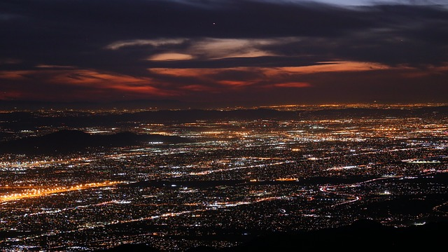 the Inland Empire lit up at night with San Bernardino Mountains in the distance