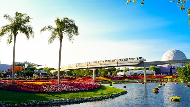 Orlando, Florida monorail with colorful flowers and palm trees in the foreground
