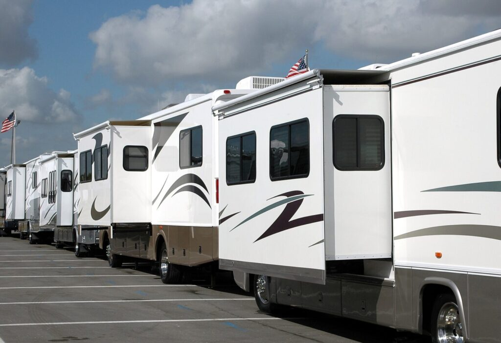 Line of class A RVs with slides