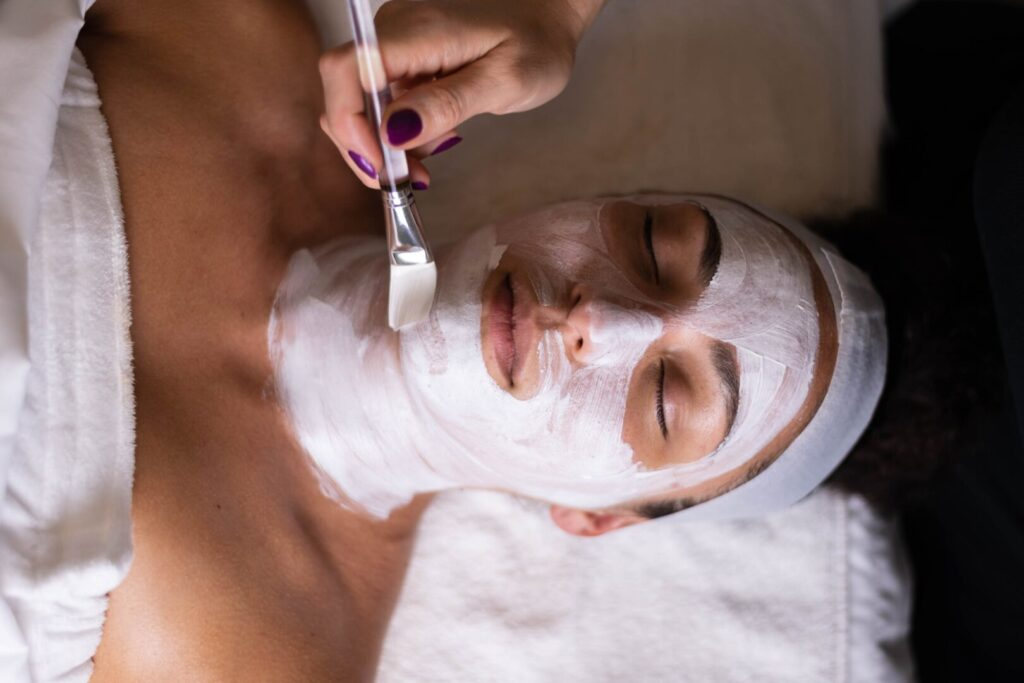 a woman relaxing and getting a spa treatment