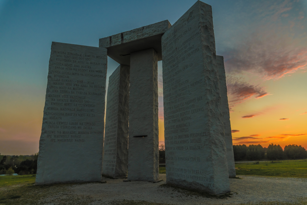 """ELBERT, GEORGIA - APRIL 2: The Georgia Guidestones, also known as the """"American Stonehenge"""", as seen on April 2, 2018 in Elbert, GA. The inscription is of 10 principles in 8 different languages."""