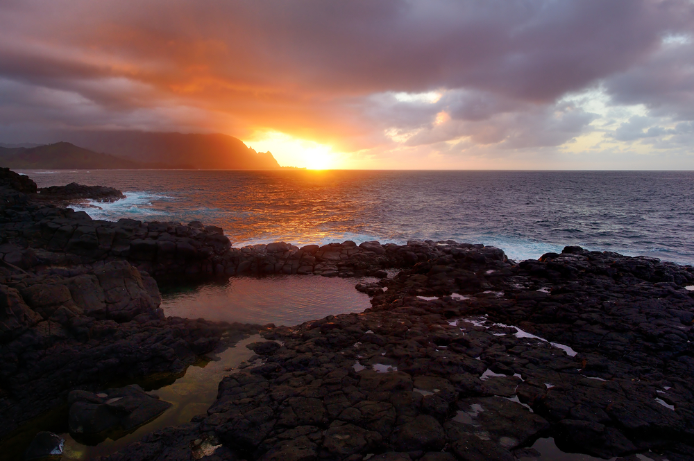 Queen's Bath on sunset on the island of Kauai, Hawaii. The pools are sinkholes surrounded by lava rock.