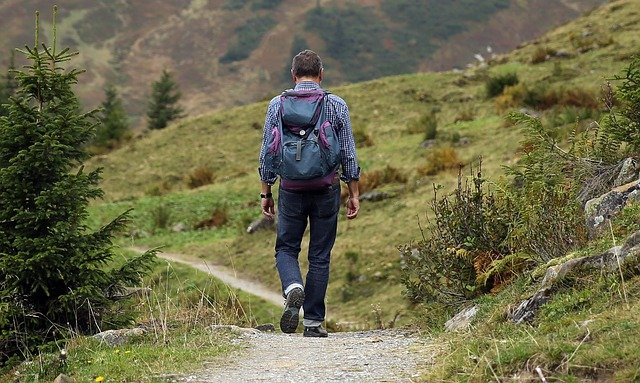 person hiking in the hills
