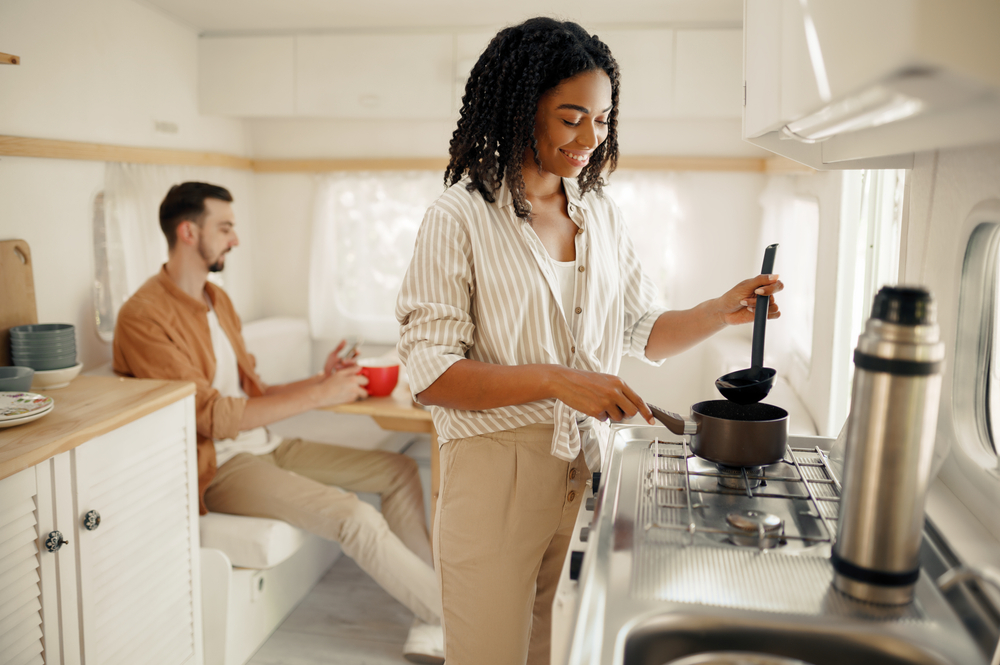 couple cooking in rv kitchen