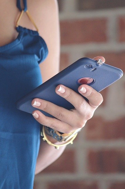 woman with cell phone in her hand