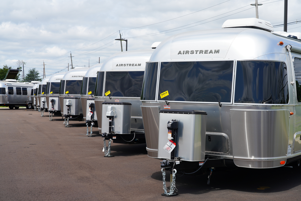 View of aluminum Airstream RV trailers sold on the lot of the Colonial motorhomes dealership in Millstone Township, New Jersey, USA.