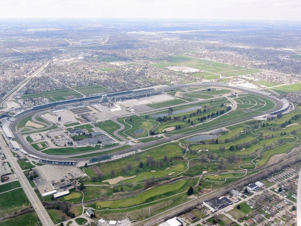 Aerial view of Indianapolis 500, an automobile race held annually at Indianapolis Motor Speedway in Speedway, Indiana through clouds. View from airplane.  J