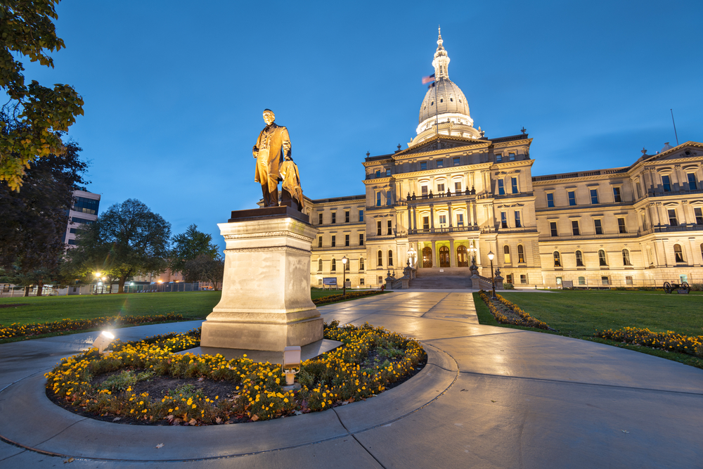 Lansing, Michigan, USA at the Michigan State Capitol during the evening. (Governor Austin Blair statue dedicated in 1898)