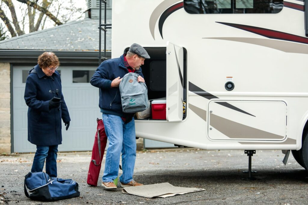 People packing an RV