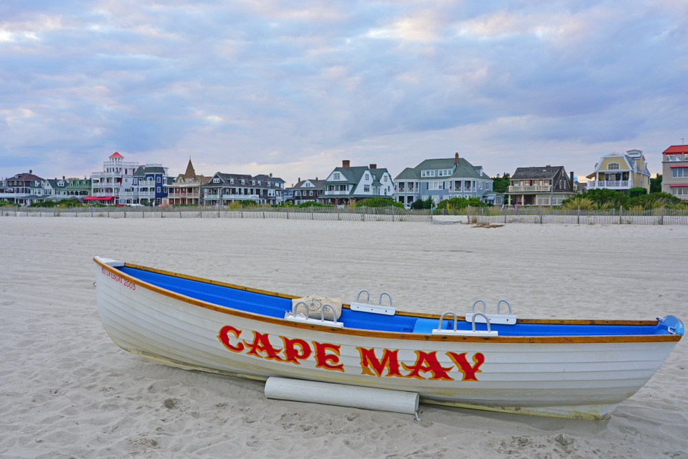 CAPE MAY, NJ -8 SEP 2019- View of a boat with a Cape May sign on the beach in Cape May, New Jersey, USA.