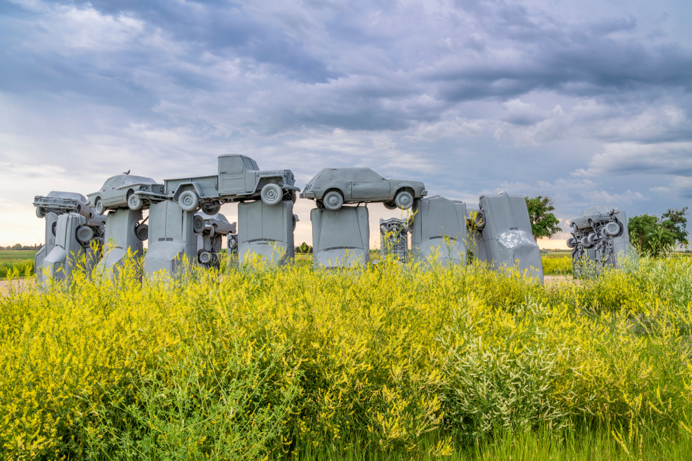 Alliance, NE, USA - July 15., 2019: Carhenge, car sculpture created by Jim Reinders, a modern replica of England's Stonehenge using old cars, a summer scenery with a field of yellow sweet clover.