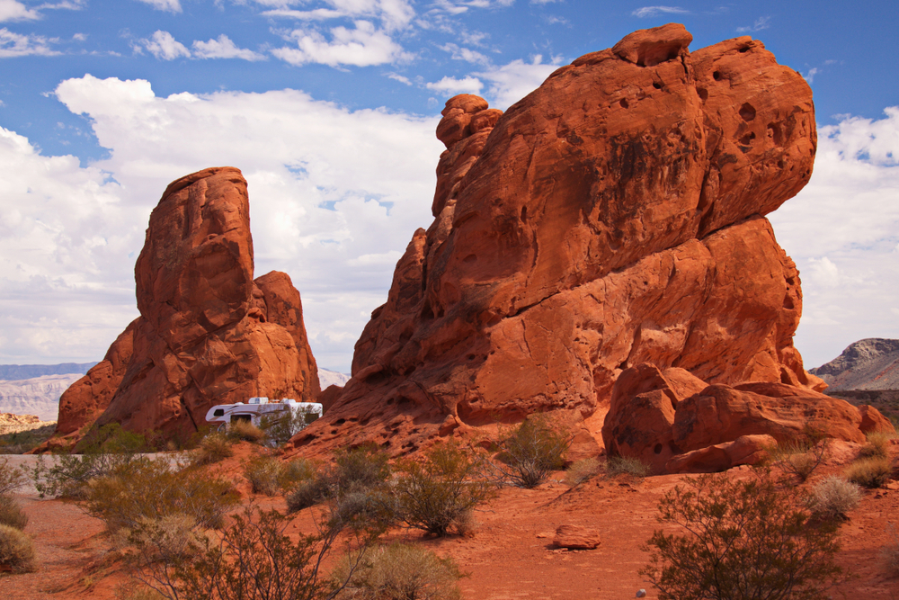 Large, red rock formations and RV in Valley of Fire State Park in Nevada.