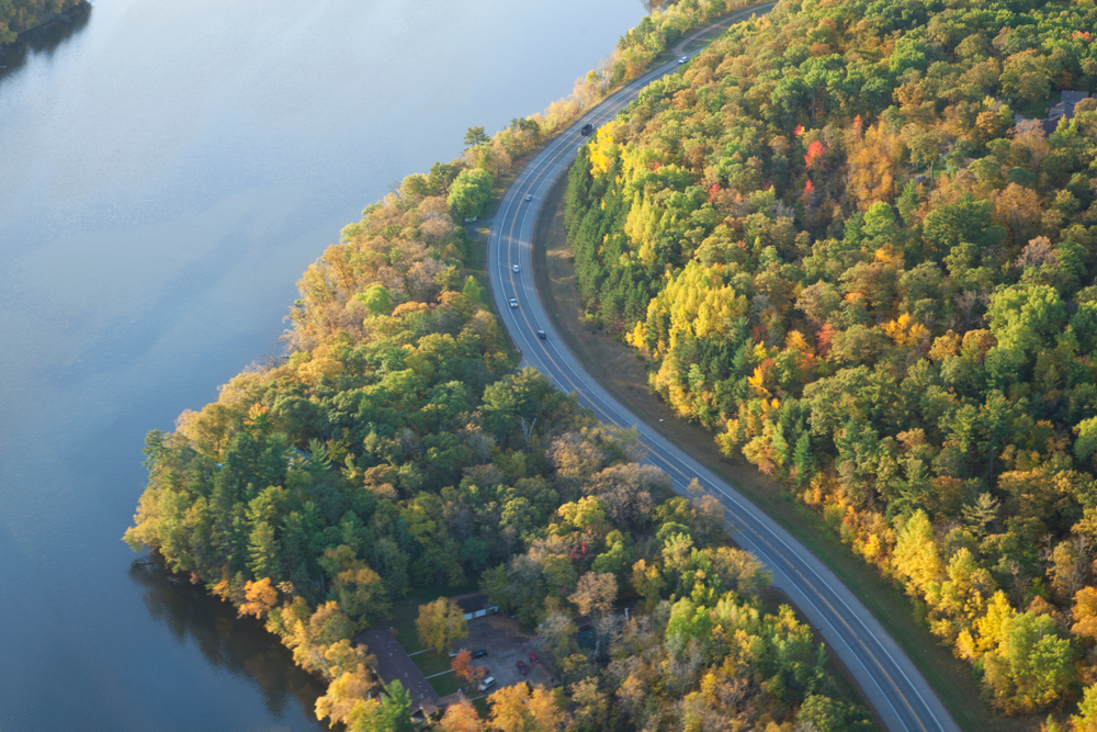 Aerial view of curving road along Mississippi River in northern Minnesota on a bright autumn morning