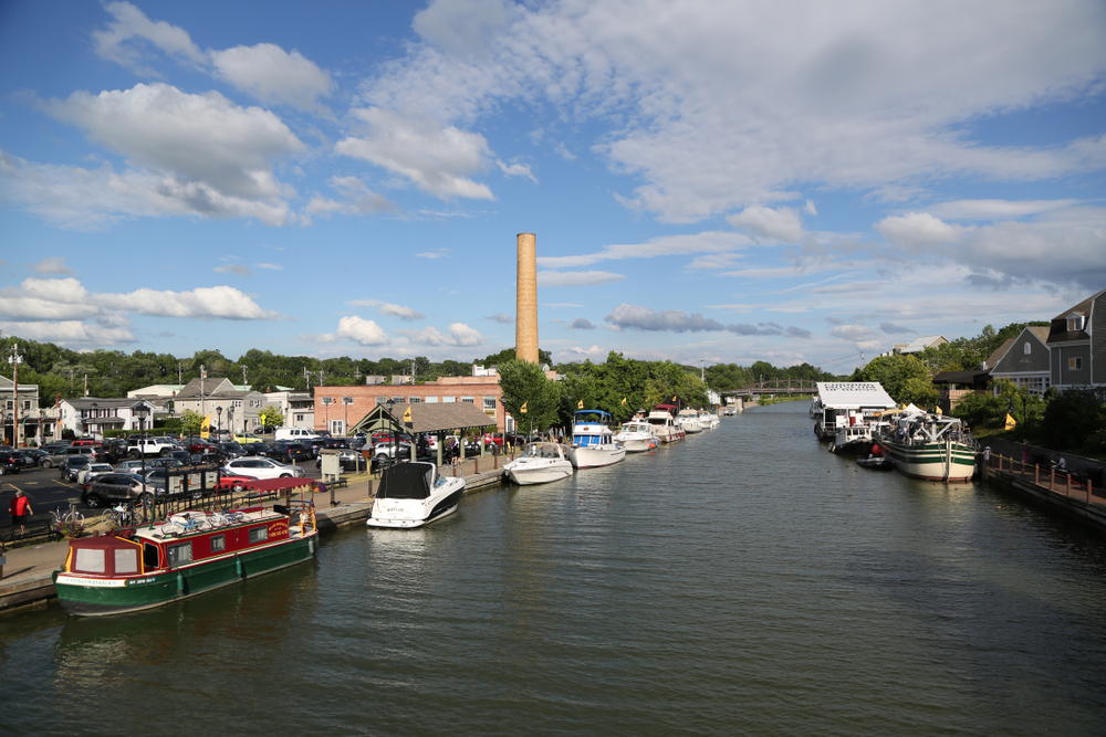FAIRPORT, NEW YORK - JULY 21, 2018: Boats docked along Erie Canal in Fairport, Upstate New York
