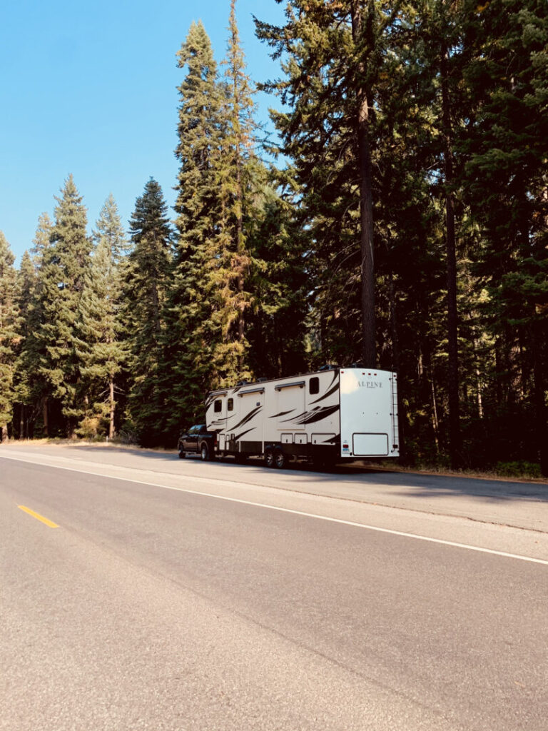 Fifth-wheel RV trailer parked on the side of the road