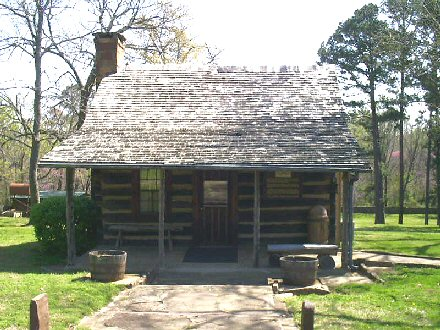 Reproduction of the log cabin of Sequoyah, a renowned Native American leader, and now a Native American museum in Sequoyah County, Oklahoma. The original, located inside an adjacent protective building, is on the National Register of Historic Places.