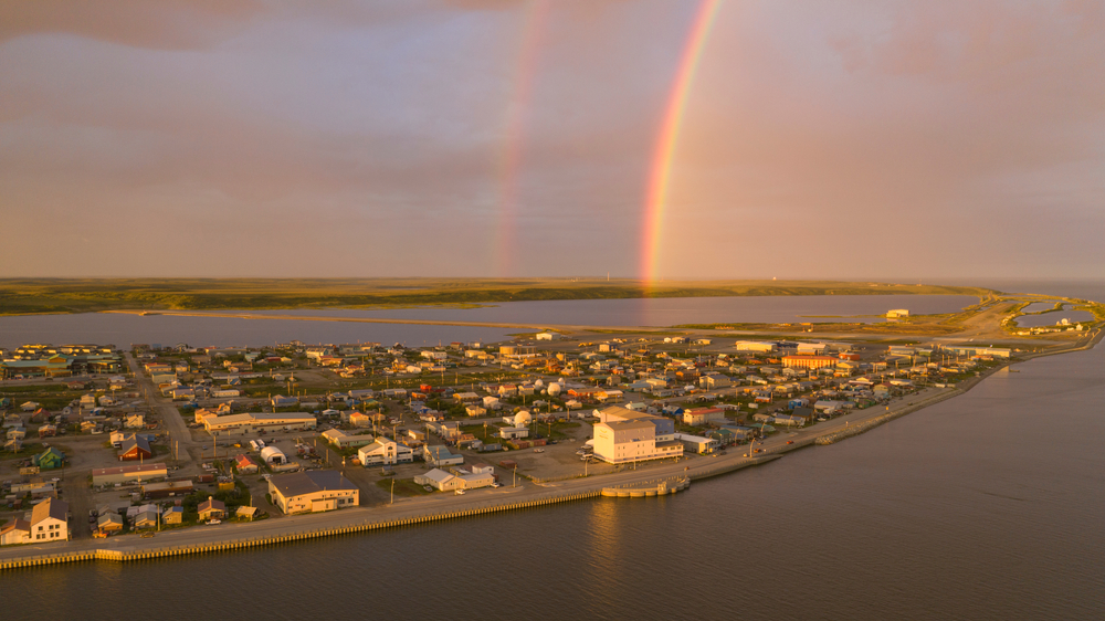 Rainbow forms at sunset over the little town of Kotzebue in Alaska