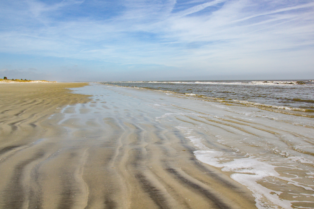 A beach without any people. The gentle waves roll in on the rippled sand on Sapelo Island, GA