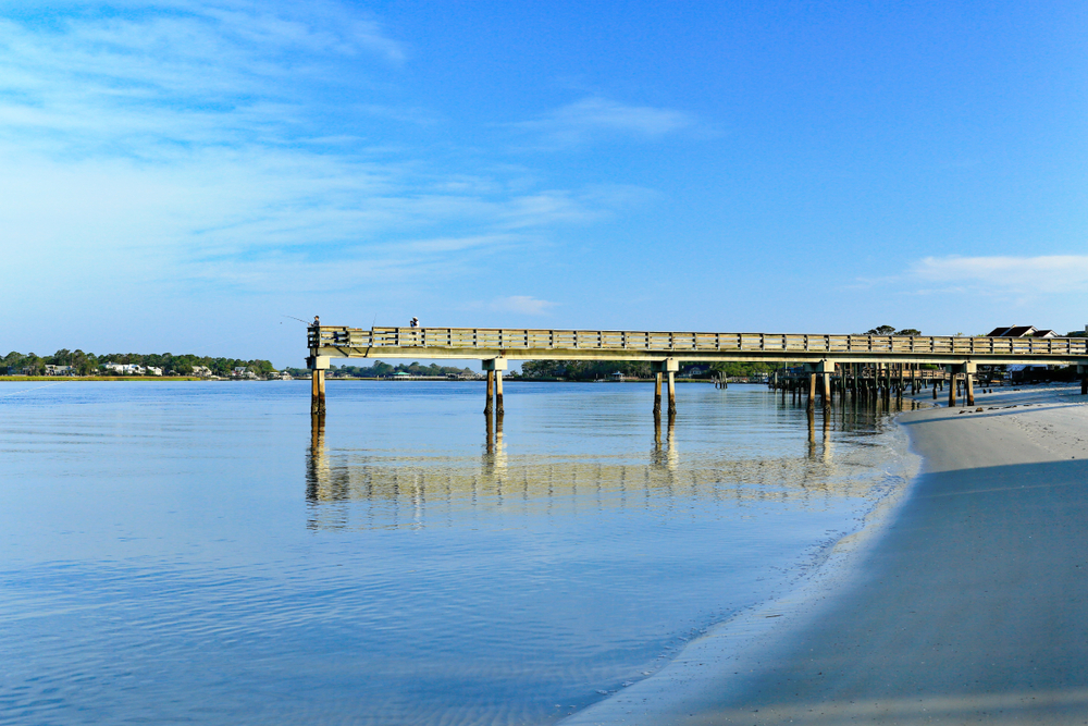 Early morning at the south end of Tybee Island beach. A view of the Tybee Creek side of the island and the Back River Fishing Pier