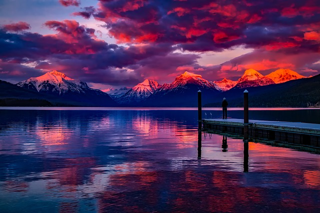 Lake McDonald at Glacier National Park at sunset with a red and purple sky
