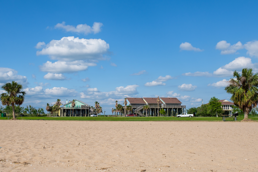 CYPREMORT POINT, LA, USA - MAY 13, 2021: Cabins and staff housing at Cypremort Point State Park with beach in foreground
