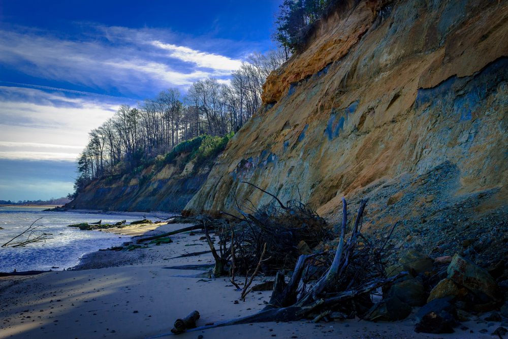 Hiking at Calvert Cliff State Park in Maryland. The clay cliffs contrast nicely with both the sky, and Bay.
