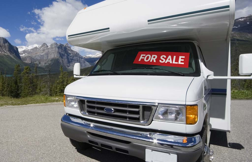 RV with a sale sign in the window