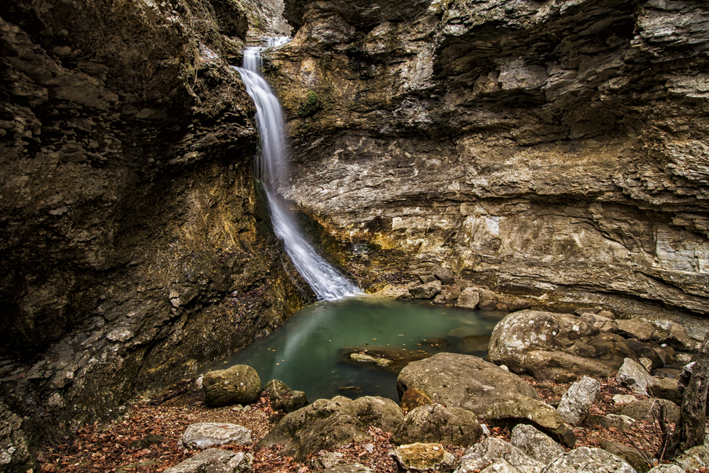 A horizontal image of Eden Falls in Arkansas. It is just one of several waterfalls in Arkansas.