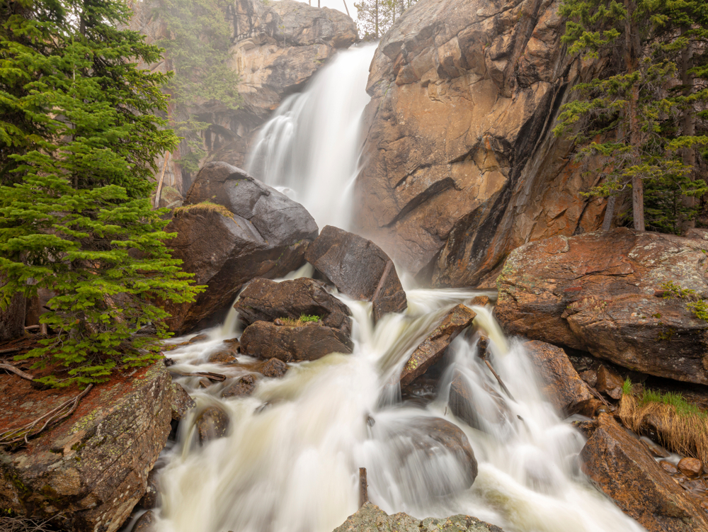 Mist and spray come off Ouzel Falls during high Spring runoff in the Wild Basin area of Rocky Mountain National Park, Allenspark, Colorado.
